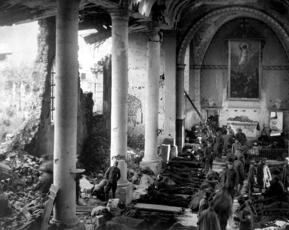 This shattered church in the ruins of Neuvilly furnished a temporary shelter for American wounded being treated by the 110th Sanitary Train, 4th Ambulance Corps.  France, September 20, 1918. Sgt. J. A. Marshall. (Army)