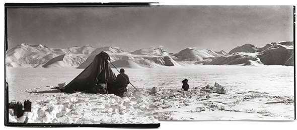 Dr Edward Wilson, the chief of the scientific staff, sketches the mountain ranges and tributary glaciers of the Beardmore Glacier, 13 December 1911. Photographed by Captain Scott.