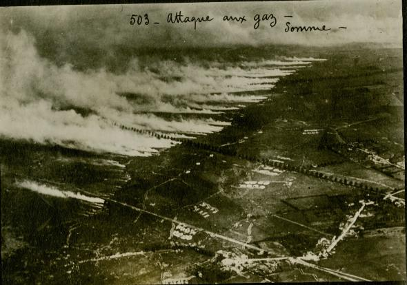Aerial photograph of a gas attack on the Somme battlefield using metal canisters of liquid gas. When the canisters were opened in a stiff, favourable wind, the liquid cooled into a gas and blew outwards and over the enemy lines. Strong concentrations of gas could overwhelm respirators, but a change in wind direction could also reverse the cloud, which then gassed one's own troops.