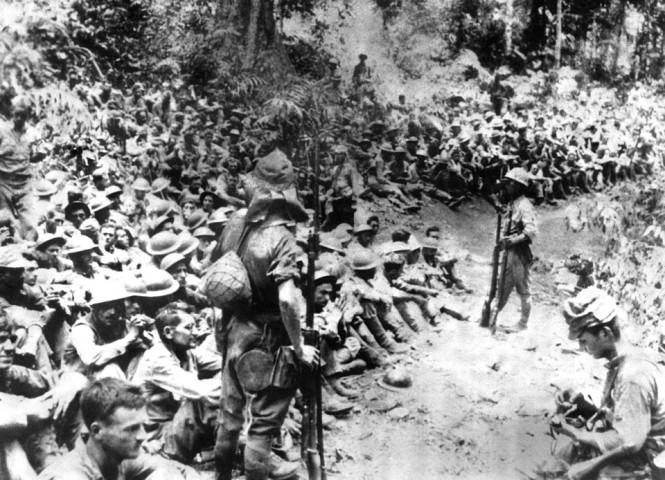 Japanese-soldiers-stand-guard-over-American-war-prisoners-just-before-the-start-of-the-Bataan-Death-March-in-1942.-This-photograph-was-stolen-from-the-Japanese-during-Japans-three-year-occupation.-