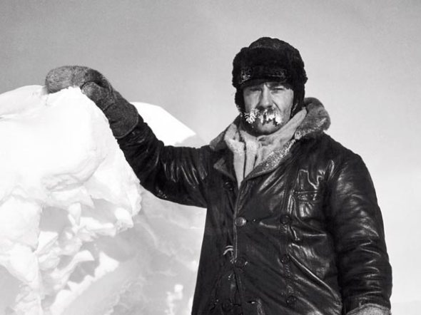 Moustache encrusted with ice, photographer Herbert Ponting stands on an iceberg near McMurdo Sound, Antarctica, in 1911. Ponting was part of the scientific staff on the 1910-1912 Terra Nova expedition to the South Pole