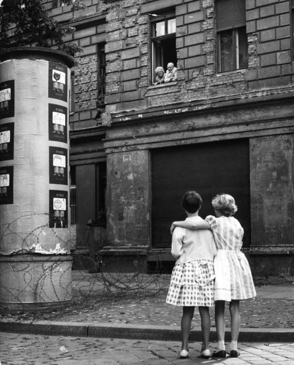 It's interesting to see the still battered buildings from the battle of Berlin show their scars. I know it took time for parts of Germany to recover and rebuild but pictures like this really put it into perspective.