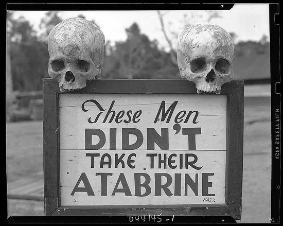 Pretty morbid that the sign was specifically designed to have human skulls placed on top of it.