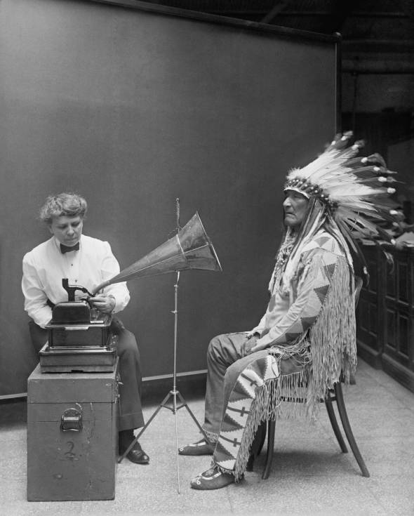 """This 1916 image of Frances Densmore and Blackfoot leader Mountain Chief listening to a cylinder recording has become a symbol of the early songcatcher era."""