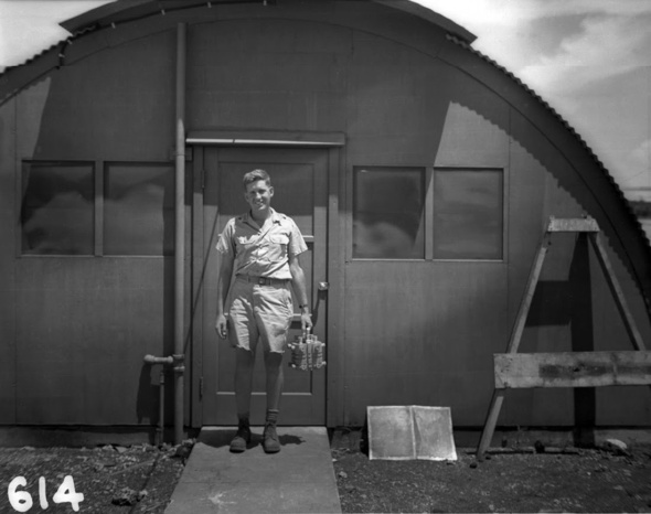 harold-agnew-carrying-the-plutonium-core-of-the-nagasaki-fat-man-bomb-1945