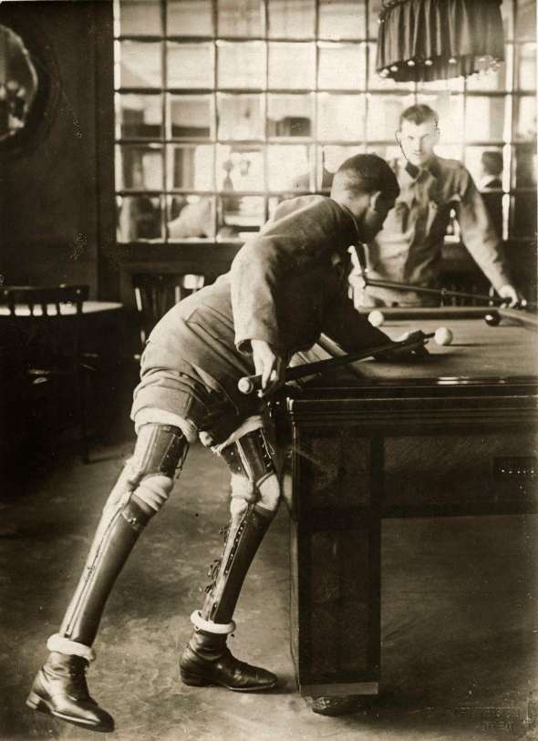 The uniform and the playing of Billiards (which was invented by British officers) makes me suspect that these men are Commonwealth forces, likely Brits.