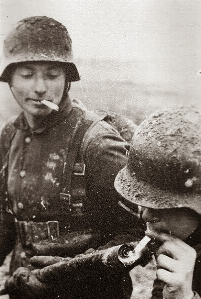 German soldier lighting his cigarette with a flamethrower; ca. 1940s.  sc 1 st  I hope to be remembered for my atrocities! - WordPress.com & German soldier lighting his cigarette with a flamethrower; ca ... azcodes.com