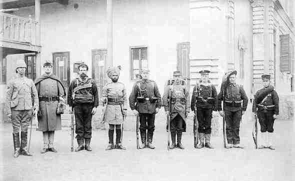 They are, from left to right: British, American, Russian, Indian, German, French, Austro-Hungarian, Italian and Japanese.
