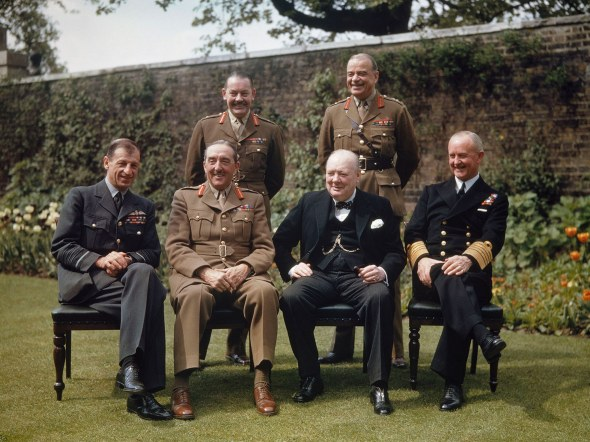 Original caption: 10 Downing Street garden, London, England 7th May 1945, Chiefs of Staff at Downing Street, Back Row, L-R; Major General Hollis, General Sir Hastings Ismay (1887-1965), Front Row, L-R; Sir Charles Portal, Marshal of the RAF, Field Marshal Sir Alan Brooke, Prime Minister Winston Churchill, Admiral of the Fleet, Sir Andrew Cunningham