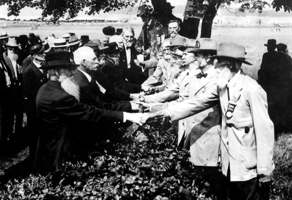 They're actually shaking hands over the stone wall at Pickett's Charge.