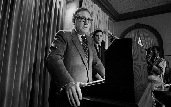 "Then presidential adviser Dr. Henry Kissinger tells a White House news conference that ""peace is at hand in Vietnam"" on Oct. 26, 1972. (AP Photo)"