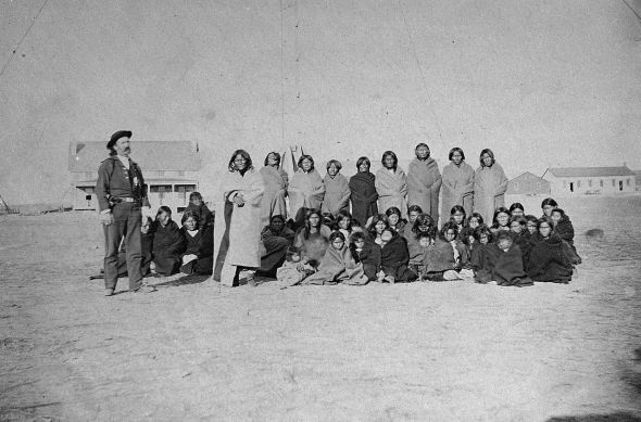 Most of the Cheyenne captives are visible in this photograph, taken at Fort Dodge en route to the stockade at Fort Hays, Kansas; to the left stands U.S. Army chief of scouts John O. Austin.